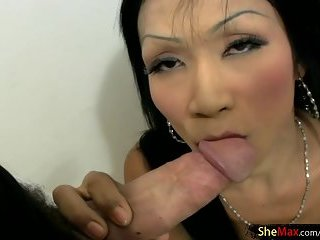 Small titted ladyboy is doing sexy dancing striptease