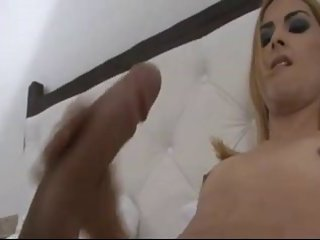 Blonde Tgirl wanking huge cock