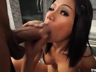 Cute Asian ladyboy takes HUGE cock