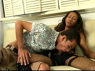 Asian tgirl in black leather gets sucked and fucked by guy on couch
