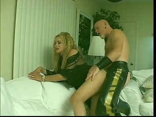Busty tgirl is fucked hard by kinky bald guy in leather outfit