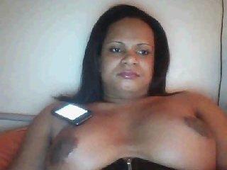 Big Breast Shemale in latex corset.